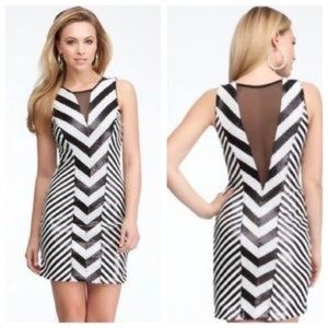 BEBE BLACK AND WHITE SEQUIN DRESS WITH MESH CUTS